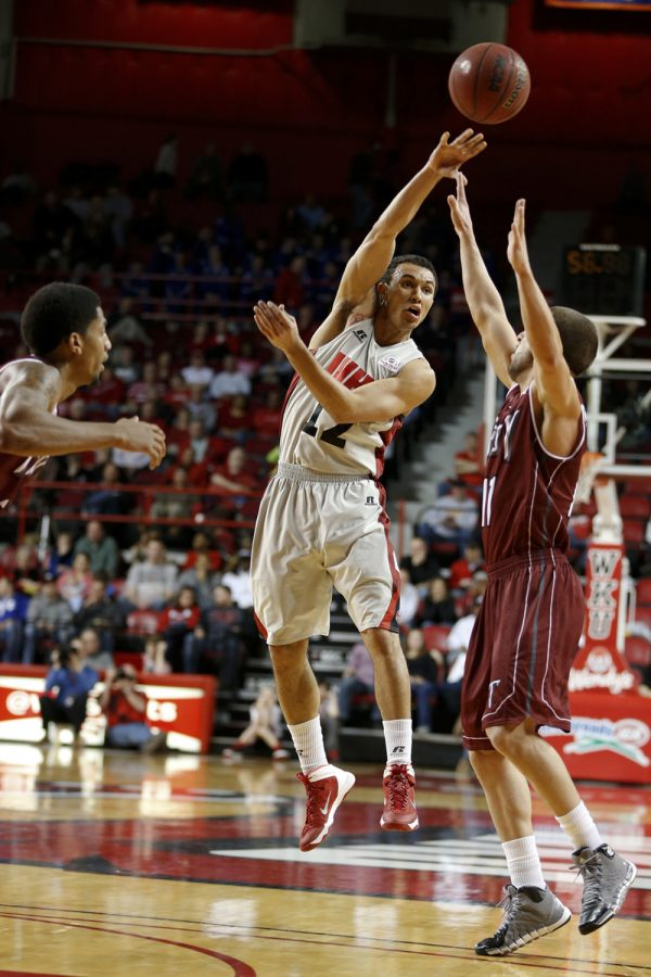 WKU senior guard Brandon Harris passes the ball over Troy in the first half of the game on Thursday, Feb. 13, 2014 at Diddle Arena in Bowling Green, Ky. (Jeff Brown/HERALD)