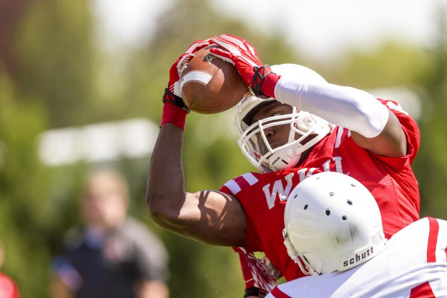 Sophomore wide receiver Taywan Taylor (2) catches a pass for a touchdown during the Red and White Spring Game Saturday, April 19, 2014, at Houchens Industries - L.T. Smith Stadium in Bowling Green, Ky. (Mike Clark/HERALD)