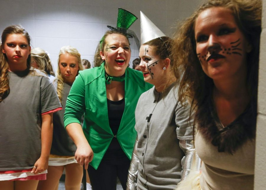 Henderson Senior Jorden Stallings laughs while waiting to take the stage with fellow members of Phi Mu during Spring Sing at Diddle Arena. (Ian Maule/HERALD)