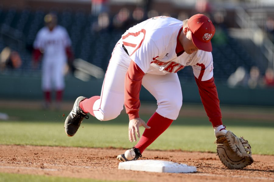 WKU junior infielder Ryan Church attempts to recovery the baseball thrown to him at first base during WKU's 5-3 lost against Louisville at the Bowling Green Ballpark in Bowling Green, Ky on Wednesday March 26, 2014. (Jeff Brown/HERALD)