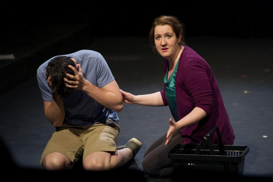 Evansville freshman Ethan Corder, left, plays an autistic child name Jace and Louisville senior J. Morgan Shaffo, right, plays his mother, Laura, during rehearsal of The Puzzle Piece for the New Works Festival. (Jeff Brown/HERALD)