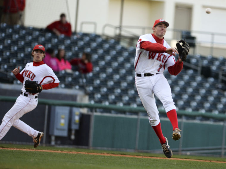 WKU+sophomore+infielder+Thomas+Peter+launches+the+ball+to+first+base+to+out+a+University+of+Louisville+runner+during+the+teams%27+matchup+on+Wednesday.+The+Toppers+lost+to+the+Cardinals+5-3+at+the+Bowling+Green+Ballpark.+%28Jeff+Brown%2FHERALD%29