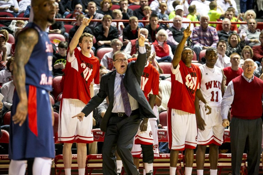 Head coach Ray Harper and the Toppers bench argue for a penalty against South Alabama during the second half of WKUs 69-62 loss against South Alabama on Saturday, Feb. 15, 2014 at Diddle Arena in Bowling Green, Ky.(Mike Clark/HERALD)