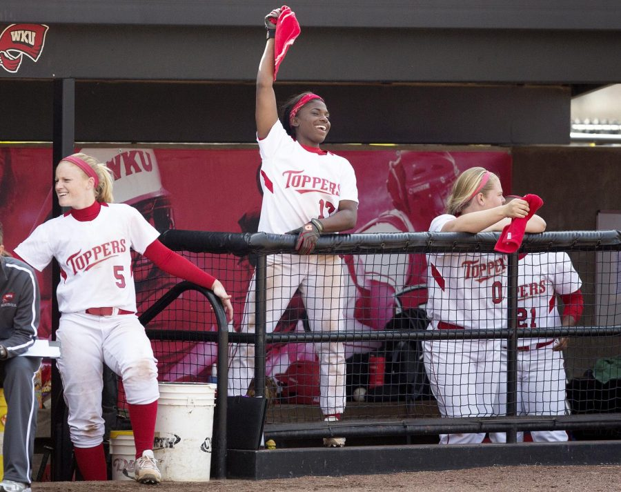 Senior+second+baseman+Olivia+Watkins+cheers+on+her+team+during+the+first+game+of+a+double-header+against+the+University+of+Louisville+on+March+19%2C+2014.+%28Luke+Franke%2FHERALD%29