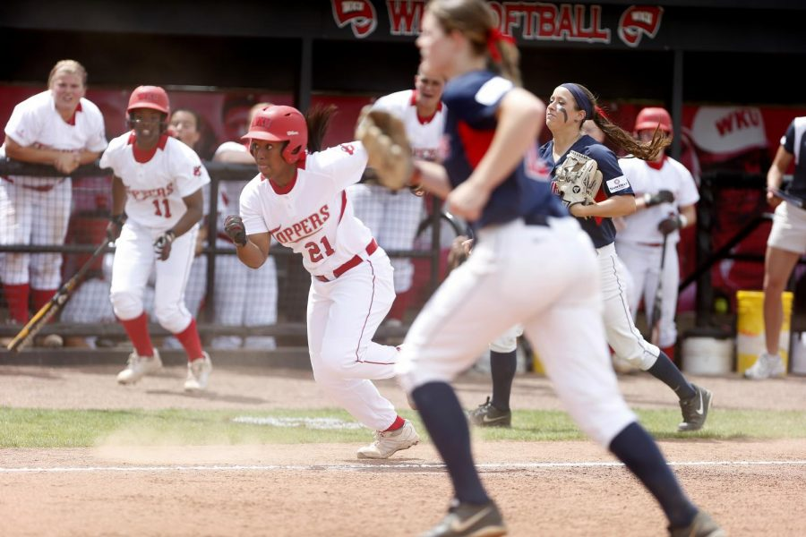 Senior outfielder Kelise Mattox runs home after a passed throwing error by South Alabama during the first game of their double header Saturday. The Lady Toppers lost 3-2. (Ian Maule/HERALD)