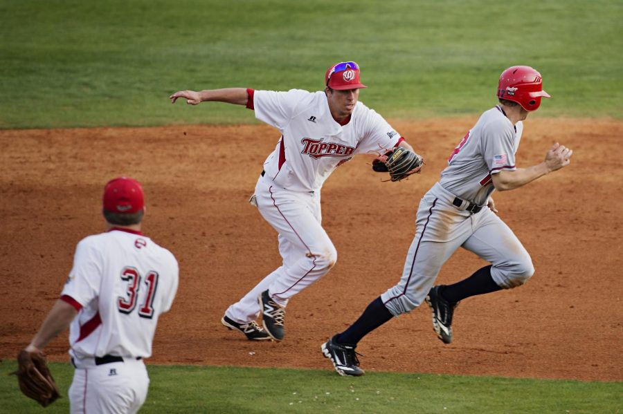 WKU junior Cody Wofford tags South Alabama's Adam Ballew in a rundown during their game at Nick Denes field on Friday, April 18, 2014. Despite a strong offense, the Hilltoppers fell to USA 13-10. (Brian Powers/HERALD)