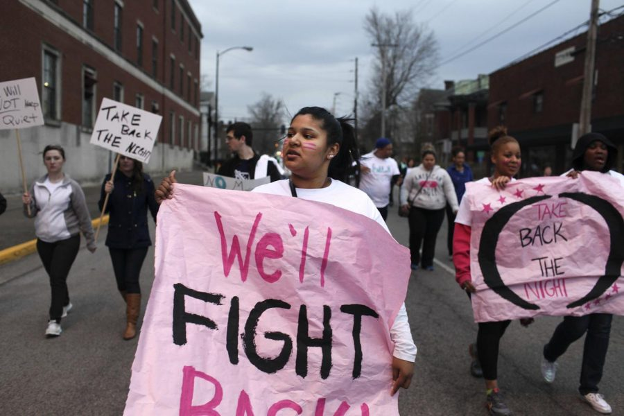 Freshman Lesha Sanchez marches with her friends from Gilbert Hall to downtown Bowling Green during Take Back the Night on Thursday. (Abbey Oldham/HERALD)