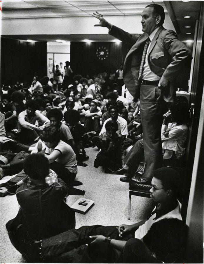 President Dero Downing talks to students who rallied at the Adminstration Building to protest that two African-Americans be added to the university cheerleading squad on Sept. 8, 1972.