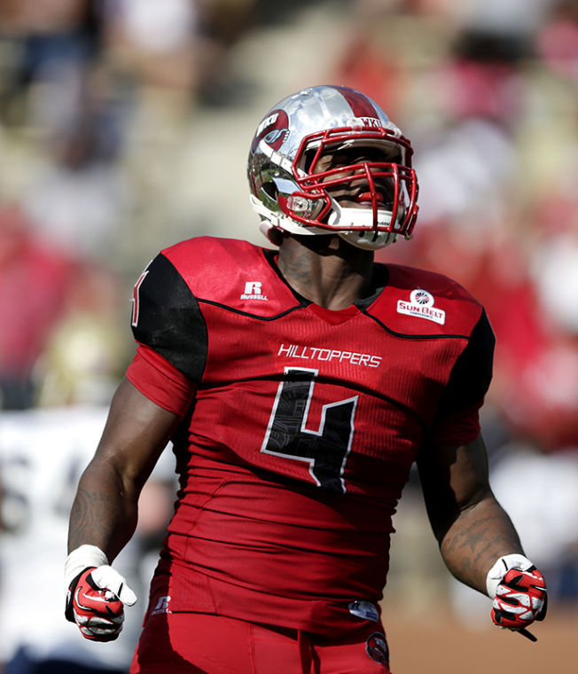 WKU's Andrew Jackson celebrates after a defensive stop during their game against Navy at Western Kentucky University on Saturday, September 28, 2013.