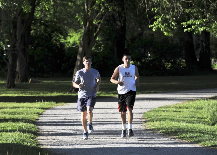 Murfreesboro sophomore Connor Shea, left, and Mt. Washington senior Jeremy Raley run at Kereiakes Park on Tuesday to train for their first Ironman Triathalon, which will take place July 12 in Muncie, Ind. (Jeff Brown/HERALD)