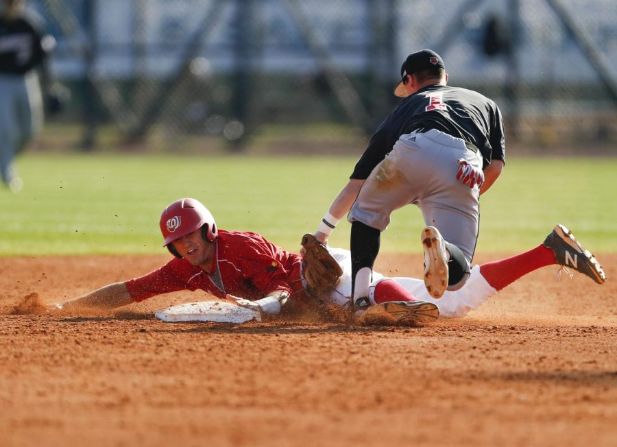 Sophomore third baseman Thomas Peter avoids being tagged by Arkansas State freshman infielder Eric Wilcoxson during their 9-6 victory Saturday over the Red Wolves. WKU won two games out of the three-game series against their conference rivals. (Ian Maule/HERALD)
