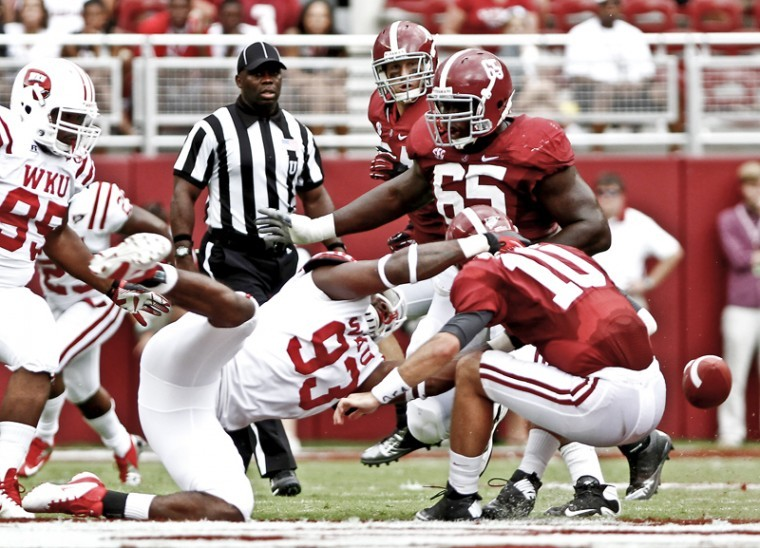 WKU defensive lineman Quanterus Smith sacks Alabama quarterback AJ McCarron, forcing a fumble in the process, at Bryant-Denny Stadium in Tuscaloosa, Ala., Saturday, Sept. 8. The Hilltoppers lost 35-0 to the defending BCS National Champions.