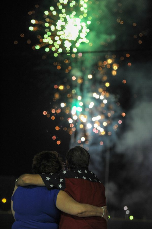 A+couple+hugs+each+other+as+4th+of+July+fireworks+go+off+at+the+Bowling+Green+Hot+Rods+stadium+on+Friday.%C2%A0Jeff+Brown%2FHERALD
