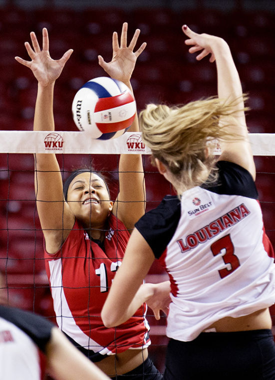 Middle hitter Noelle Langenkamp (13) blocks a spike by middle blocker Abby Filce (3) during WKU's 3-0 win against the University of Louisiana Lafayette Nov. 8, 2013, at E.A. Diddle Arena in Bowling Green, Ky.