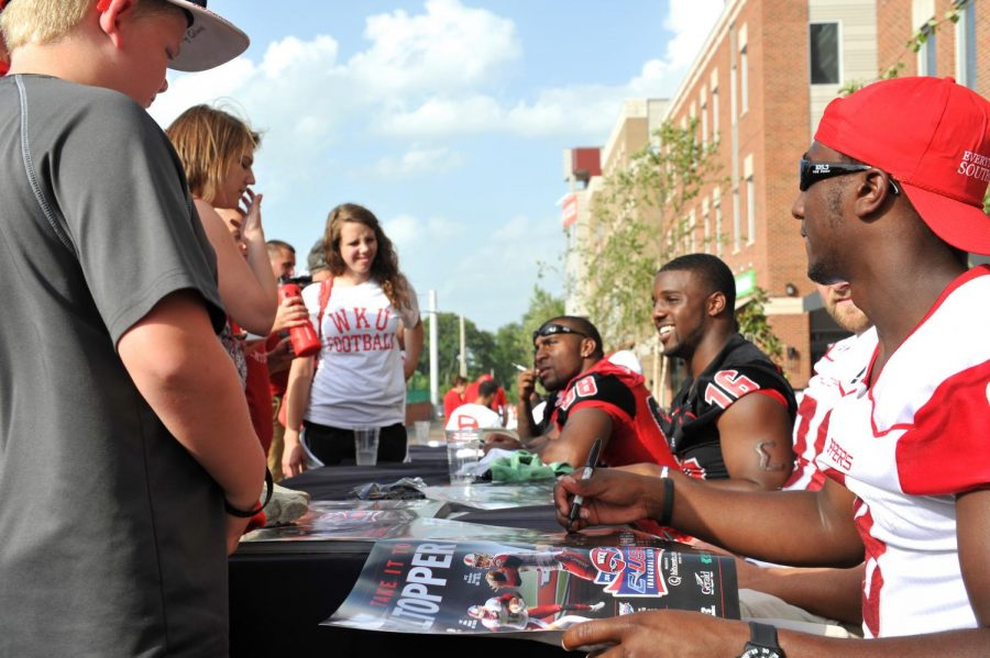 WKU football team signs autographs for fans at WKU's Conference USA kickoff party at 6-4-3 sports bar on Tuesday July 01, 2014. Jeff Brown/HERALD