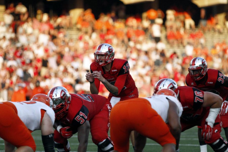 Redshirt senior quarterback Brandon Doughty calls a play during the first half of WKU's game against Bowling Green State Friday, Aug. 29, 2014, at Houchens Industries - L.T. Smith Stadium in Bowling Green, Ky.Mike Clark/HERALD