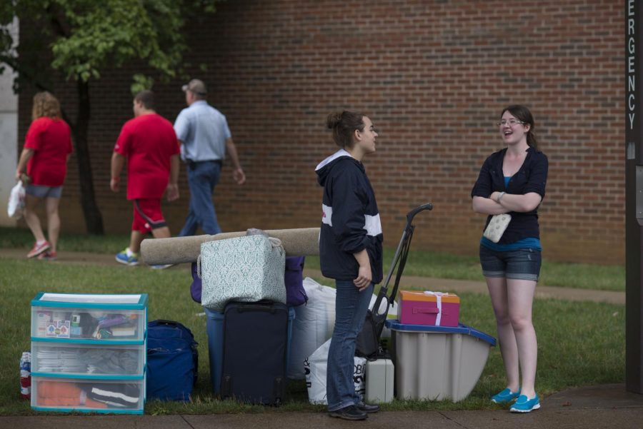 Bowling Green senior Rebecca Lauth, a member of Omega Phi Alpha sorority,assisted with MASTER Plan move in on Sunday, August 17, 2014. Kelley Schutte, right, of Independence helped her sister move into Gilbert Hall.William Kolb/HERALD