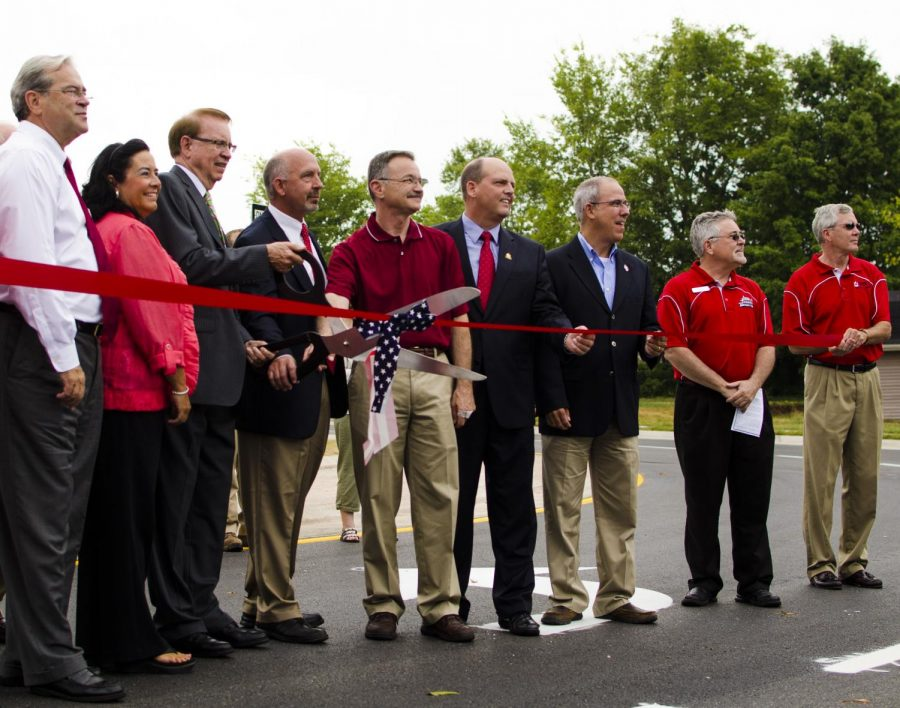 Bowling Green officials cut a ribbon for the opening ceremony of the new roundabout in Bowling Green, Aug. 8, 2014. TANNER COLE/HERALD