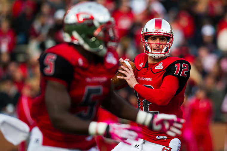 Western Kentucky Universitys Brandon Doughty looks for a pass during their game at against Troy at WKU on Saturday, October 26, 2013.