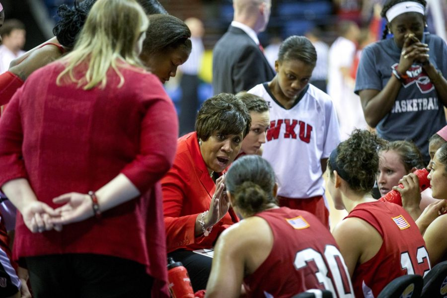WKU's head coach Michelle Clark-Heard speaks to the Lady Toppers during a timeout in the final minutes of their 61-60 victory over Arkansas State in the championship game of the Sun Belt Tournament Saturday, March 15, 2014, at Lakefront Arena in New Orleans, La. The Lady Toppers secured a place in the NCAA tournament with their win. (Mike Clark/HERALD)