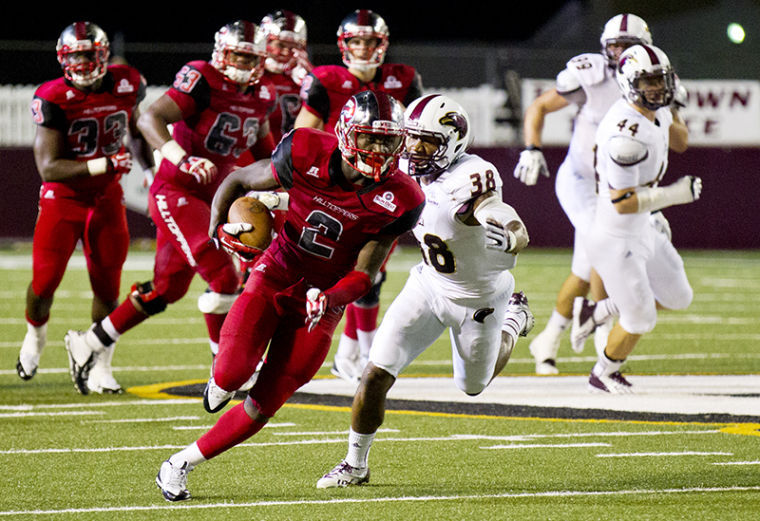 Wide+receiver+Taywan+Taylor+tries+to+outrun+safety+Mitch+Lane+%2838%29+during+the+second+half+of+the+WKU+vs.+University+of+Louisiana+Monroe+game+Thursday%2C+Oct.+3%2C+2013%2C+at+Malone+Stadium+in+Monroe%2C+La.