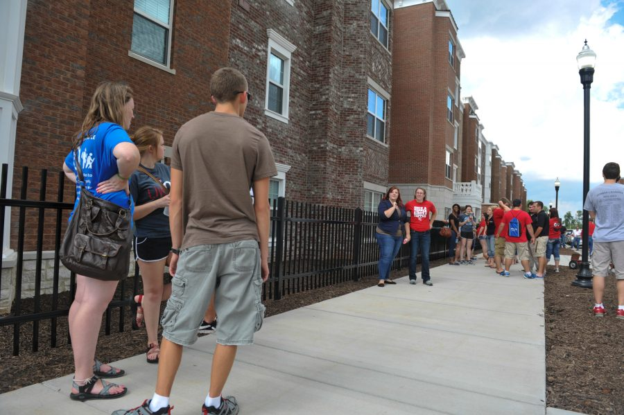 WKU students hangout in front of the new apartments on Kentucky Street on Monday Aug. 11, 2014. JEFF BROWN/HERALD