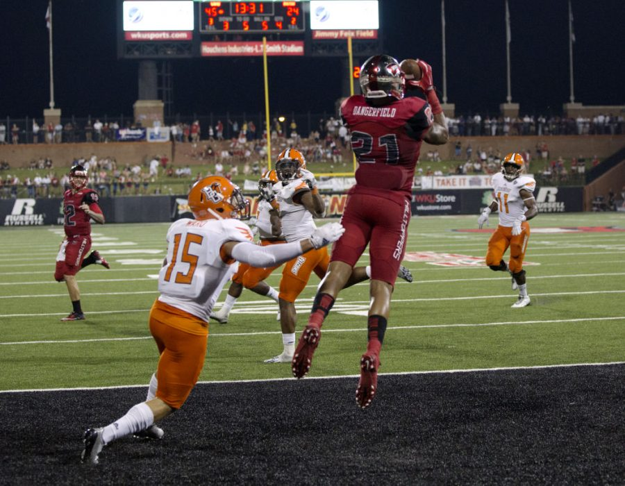 Junior+wide+receiver+Jared+Dangerfield+%2821%29+catches+a+touchdown+during+the+fourth+quarter+of+WKU%27s+August+29+game+against+Bowling+Green+State.+Dangerfield+finished+the+game+with+10+receptions+for+92+yards+and+two+touchdowns+in+WKU%27s+59-31+victory+over+the+Falcons.%C2%A0Brandon+Carter%2FHERALD