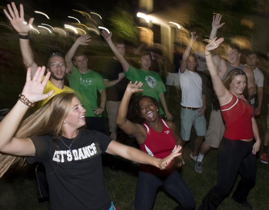 Louisville junior Alyssa Frommeyer, left, and Nashville junior Kierra Chandler, center, participate in a dance competition between the Topperettes dance team and MASTER Plan students at ROAR. ROAR, or Roast of All Rivals, is a celebration of WKUs rivalry with competing universities.William Kolb/HERALD