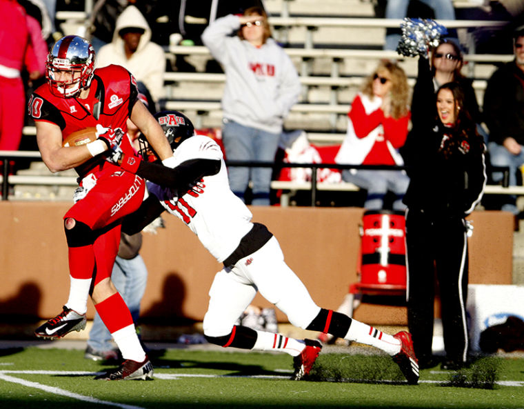 Western Kentucky Hilltoppers tight end Mitchell Henry (80) is tackled by Arkansas State Red Wolves defensive back Sterling Young during the first half of Saturdays game against Arkansas State. Western Kentucky lead 20-14 at the half.