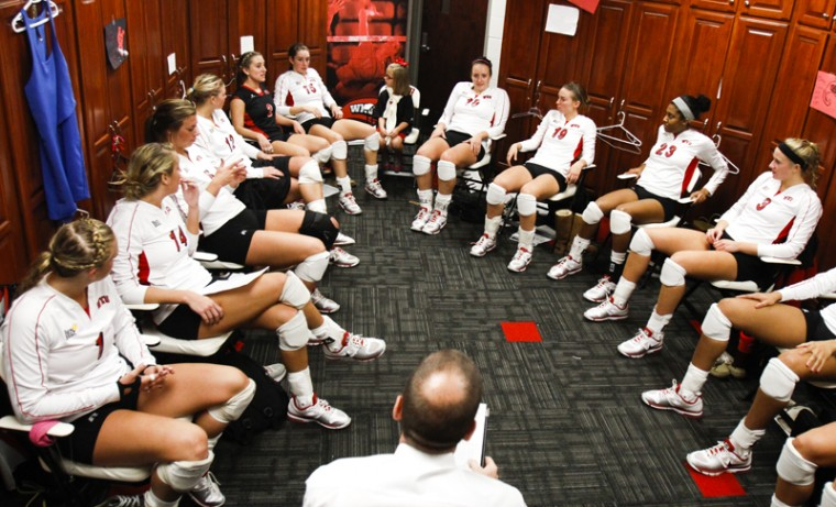 WKU head women's volleyball coach Travis Hudson addresses his team after their win over Arkansas State.
