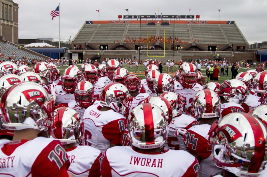 WKU gets ready for their game against the University of Illinois Saturday, Sept. 6, 2014, at Memorial Stadium in Champaign, Ill. Mike Clark/HERALD