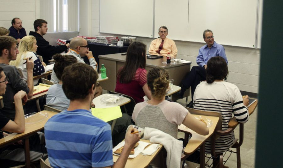 Diplomat-in-residence+Michael+McClellan+and+Soleiman+Kiasatpour%2C+associate+professor+of+political+science%2C+lead+a+discussion+with+students+and+other+faculty+about+Islam.+Luke+Franke%2FHERALD