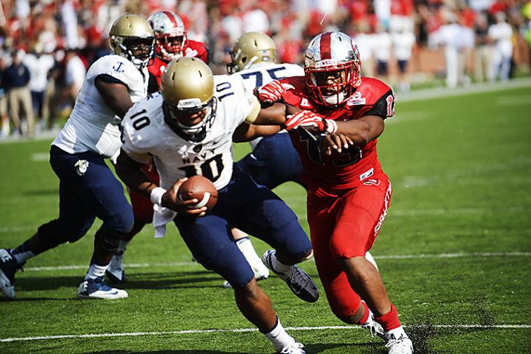 WKU senior linebacker Xavius Boyd pushes Navys junior quarterback John Hendrick into the end-zone getting WKU a safety in the fourth quarter making the final score 19-7.