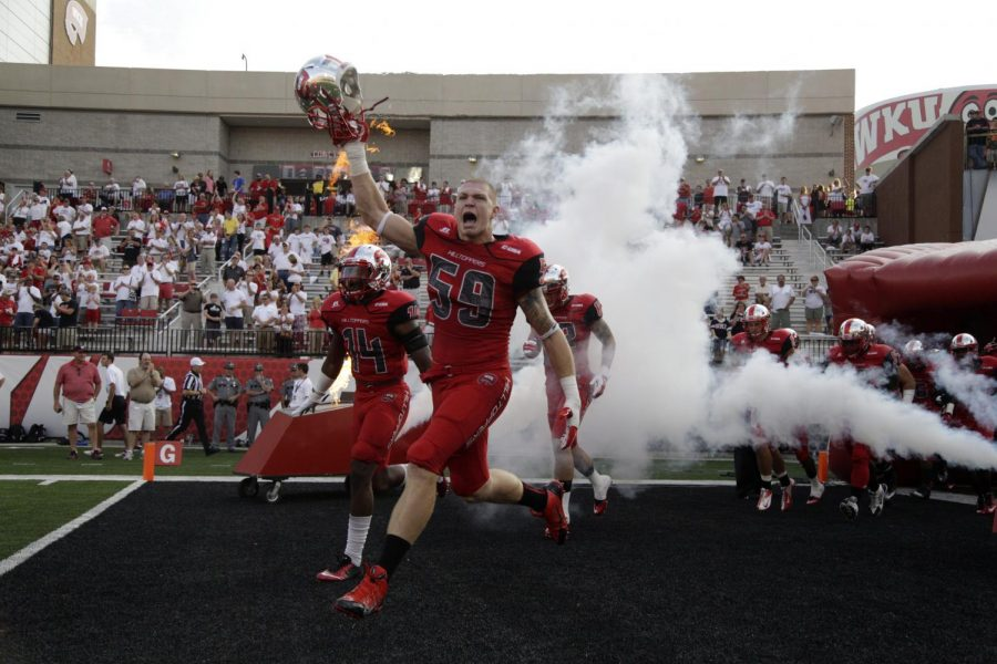 Red shirt freshman Tanner Reeves (59) leads the team to the field during the first half of WKU's game against Bowling Green State Friday, Aug. 29, 2014, at Houchens Industries - L.T. Smith Stadium in Bowling Green, Ky. Mike Clark/HERALD