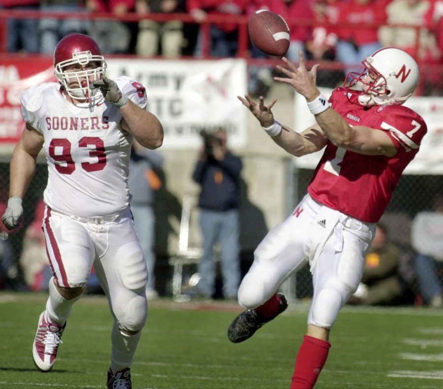 NU quarterback Eric Crouch catches a 63-yard touchdown pass from Mike Stuntz in front of Oklahoma's Kory Klein, sending the Memorial Stadium crowd into a frenzy and helping the Huskers win 20-10 in 2008.