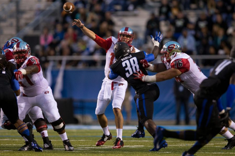 Redshirt senior quarterback Brandon Doughty passes the ball during the WKU vs Middle Tennessee State game in Murfreesboro on Sept. 13, 2014. Nick Wagner/HERALD