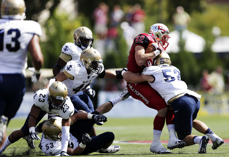 WKU's Tyler Higbee is tackled by Navy's DJ Sargenti during their game against Navy at Western Kentucky University on Saturday, September 28, 2013.