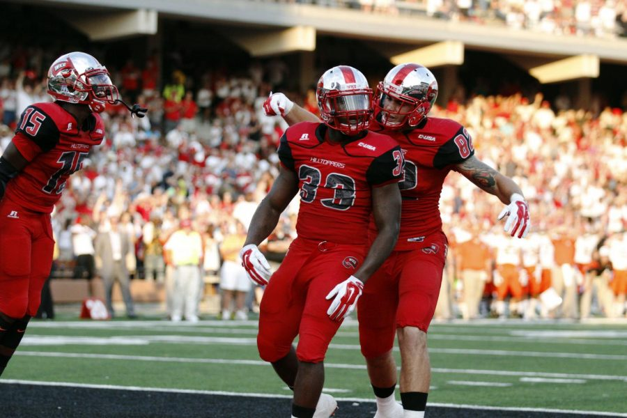 Red shirt junior Tyler Higbee (82) congratulates junior running back Leon Allen (33) on a touchdown during the first half of WKUs game against Bowling Green State Friday, Aug. 29, 2014, at Houchens Industries - L.T. Smith Stadium in Bowling Green, Ky. Mike Clark/HERALD