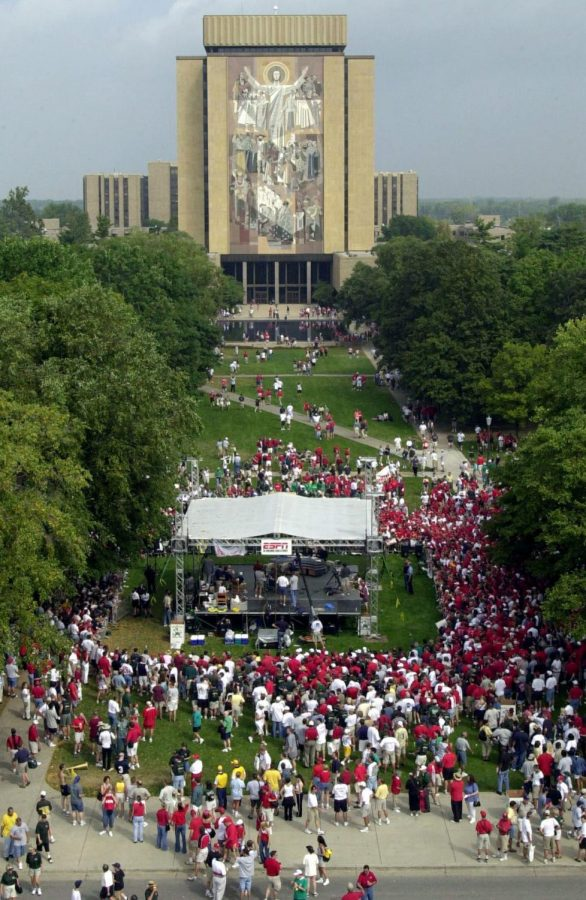 Nebraska fans gather outside Notre Dame Stadium with Touchdown Jesus in the background before the Sept. 9, 2000, game in South Bend, Ind. Some 30,000 Husker fans took over the stadium.