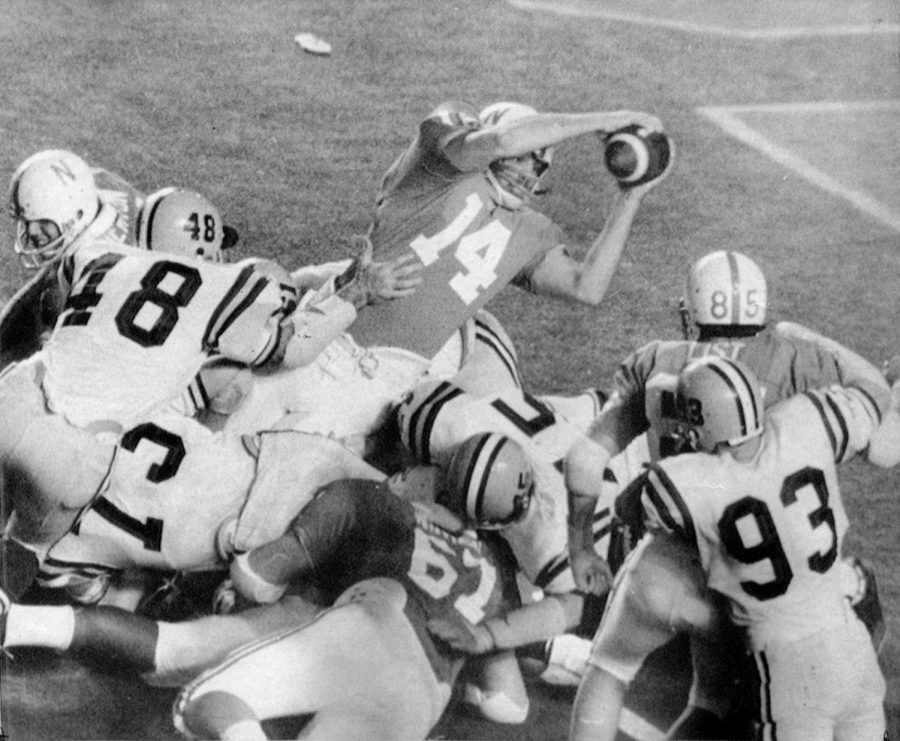 Quarterback Jerry Tagge stretches the ball over the goal line to give Nebraska the lead against LSU in the 1971 Orange Bowl. Tagge's sneak was the decisive score in a 17-12 victory that gave Nebraska its first national championship.