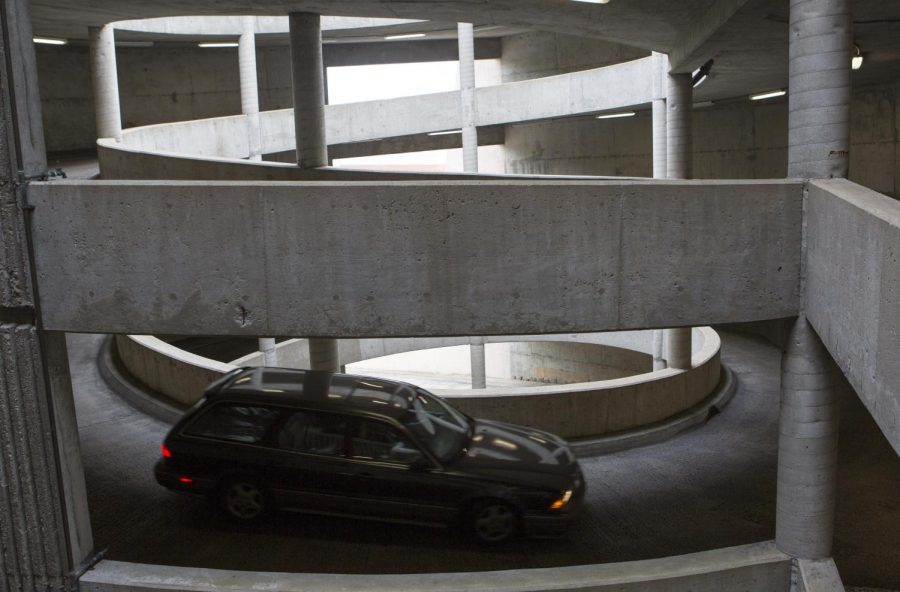 A student drives down the spiral after parking in Parking Structure 1. Jake Pope/HERALD