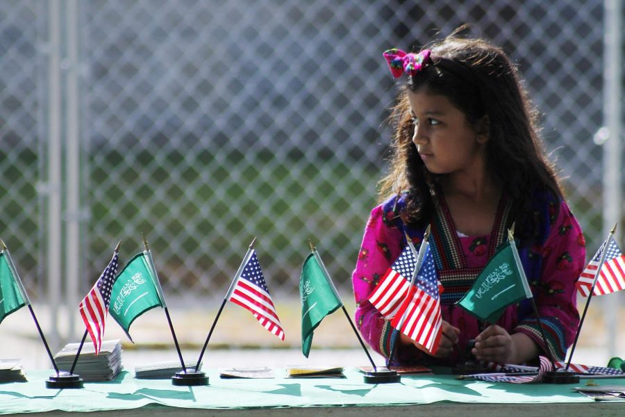 A young girl rearranges flags outside the Saudi Arabian Cultural Mission information tent at the International Festival on Sept. 27.William Kolb/HERALD
