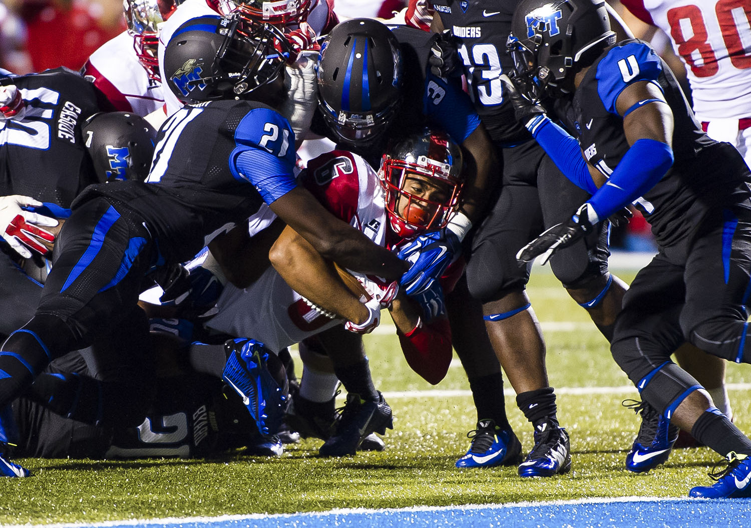 Redshirt sophomore wide receiver Joel German is taken to the ground by the MTSU defense during the WKU vs MTSU game on Sept. 13, 2014. Nick Wagner/HERALD
