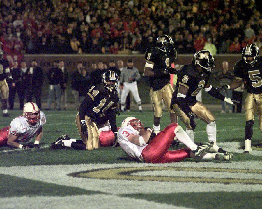 Nebraska's Matt Davison (3) cradles the ball after catching a pass that deflected off teammate Shevin Wiggins' foot with no time left in the fourth quarter of the 1997 game at Missouri.