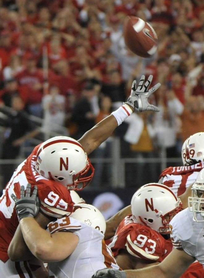 Hunter Lawrence's field goal is just out of the reach of Nebraska's Pierre Allen (95) in the 2009 Big 12 Championship Game in Arlington, Texas. Texas was given an extra second and Lawrence's 46-yard kick gave the Longhorns a 13-12 victory.