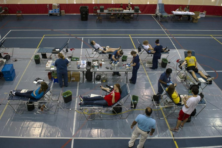 WKU students donate blood in the Preston Center on Tuesday as part of the WKU vs. MTSU Blood Drive Competition by the American Red Cross. Jeff Brown/HERALD