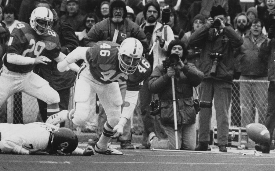 John Ruud's (46) hit on Oklahoma's Kelly Phelps (on ground) during the 1978 game at Memorial Stadium is still shown in Husker highlights. The officials ruled that Phelps was down before the fumble.