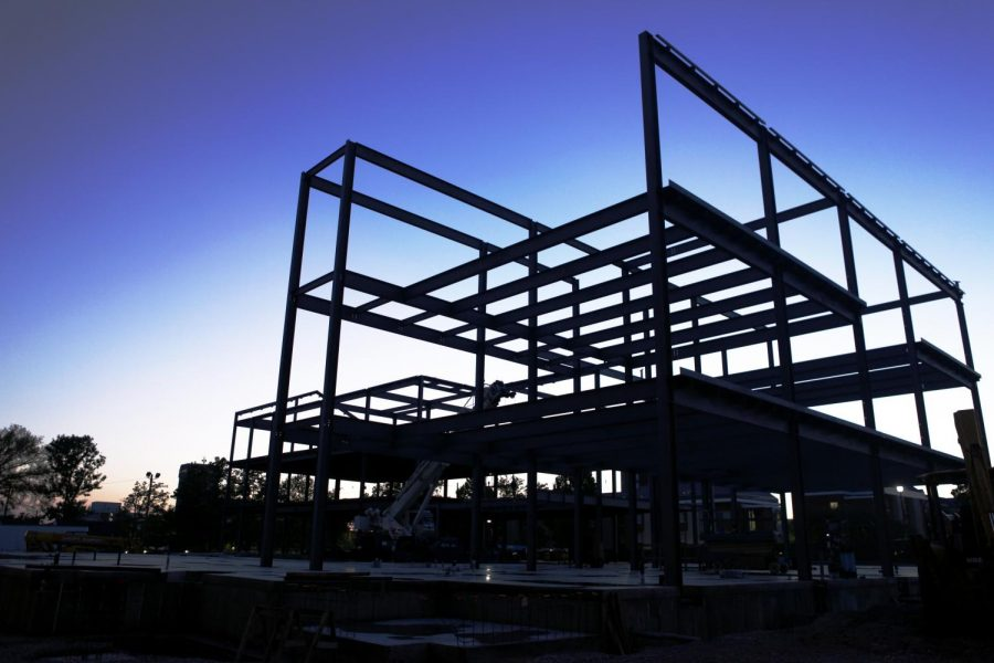 Construction continues on the new, three-story Honors College building. The building will house Honors College faculty and staff as well as KIIS, Study Abroad and Global Learning and the Office of Scholar Development. Jake Pope/HERALD
