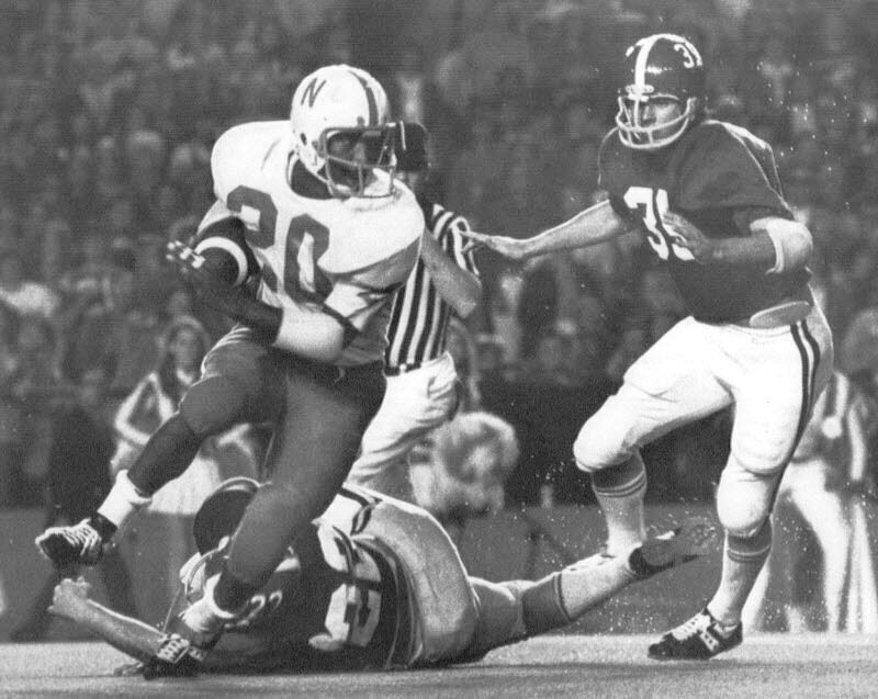 Nebraska's Johnny Rodgers (20) gets away from two Alabama defenders on his 77-yard punt return for a touchdown in NU's 38-6 victory against the Crimson Tide in the 1972 Orange Bowl.