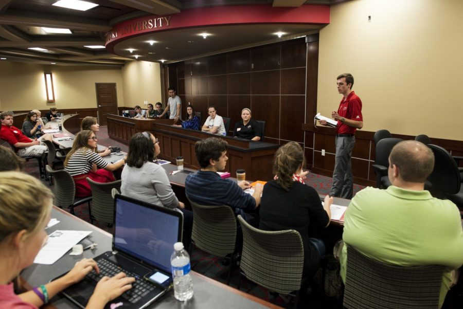 Executive Vice President Nolan Miles addresses attendees at the Student Government Association meeting in the newly constructed SGA senate chambers in the Downing Student Union on on Sept. 23, 2014. Prior to this year, SGA meetings were held in Cravens Library. William Kolb/HERALD